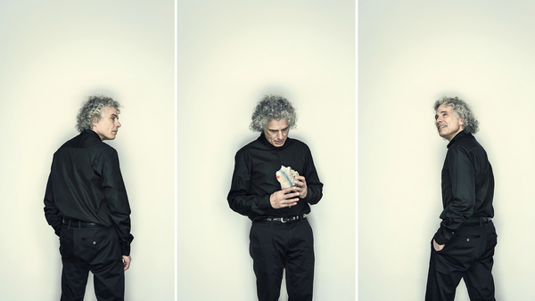 Stephen Pinker holding a piece of the Berlin Wall