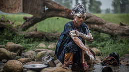 A 14-year-old girl bathes in a river in Nepal