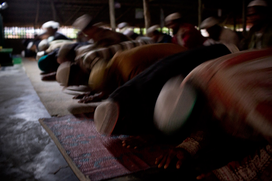 Rohingya men pray at the temporary mosque in the Thet Kal Pyin Refugee Camp.