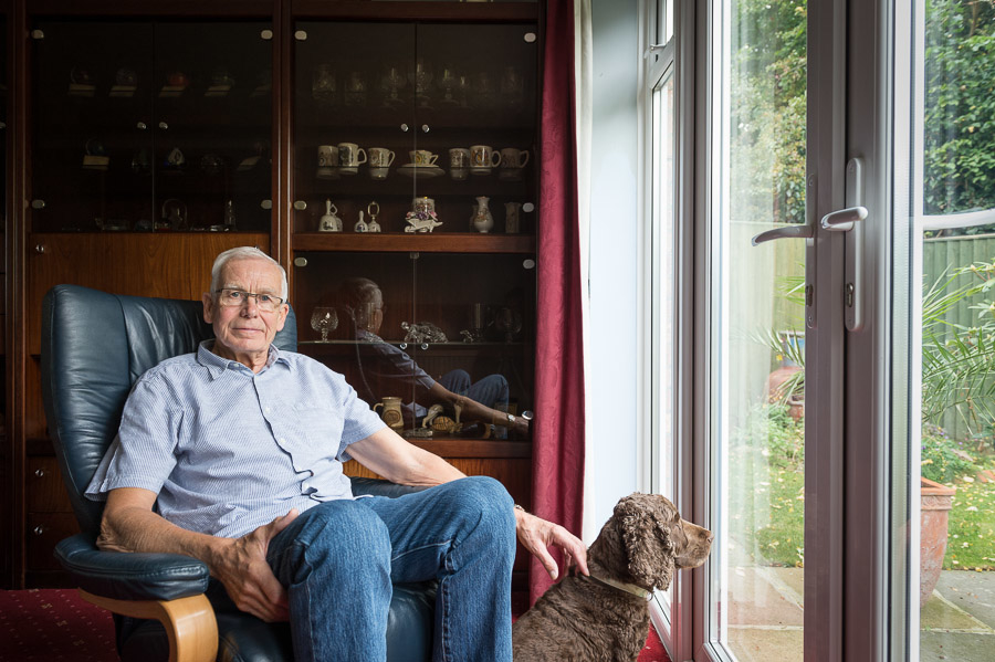 Winston Bish at home with his dog